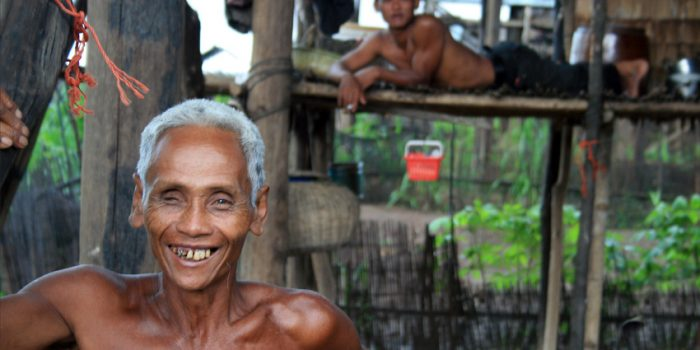 Smiling Fisherman In Tonle Sap, Cambodia